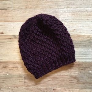 Women's burgundy knitted winter hat.